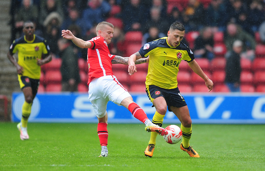 Fleetwood Town's Antoni Sarcevic vies for possession with Walsall's Jason Demetriou<br /> <br /> Photographer Chris Vaughan/CameraSport<br /> <br /> Football - The Football League Sky Bet League One - Walsall v Fleetwood Town - Monday 2nd May 2016 - Banks's Stadium - Walsall   <br /> <br /> &copy; CameraSport - 43 Linden Ave. Countesthorpe. Leicester. England. LE8 5PG - Tel: +44 (0) 116 277 4147 - admin@camerasport.com - www.camerasport.com