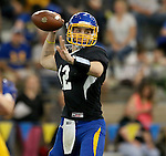 BROOKINGS, SD - APRIL 23:  Kanin Nelson #12 from South Dakota State looks for a receiver during their Spring Game Saturday afternoon at the Sanford Jackrabbit Athletic Complex in Brookings.  (Photo by Dave Eggen/Inertia)