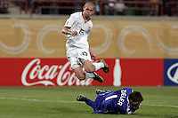 The United States' Grian Ownby (15) jumps over Germany's Goal Keeper, Ron-Robert Zieler (1) during a goal attempt in the second half of  the FIFA Under 20 World Cup Group C Match between the United States and Germany at the Mubarak Stadium on September 26, 2009 in Suez, Egypt. The US team lost to Germany 3-0.
