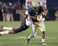 Pitt defensive back K'Waun Williams (2) returns an interception. Cincinnati Bearcats defeated the Pitt Panthers 26-23 at Heinz Field in Pittsburgh, Pennsylvania on November 5, 2011.