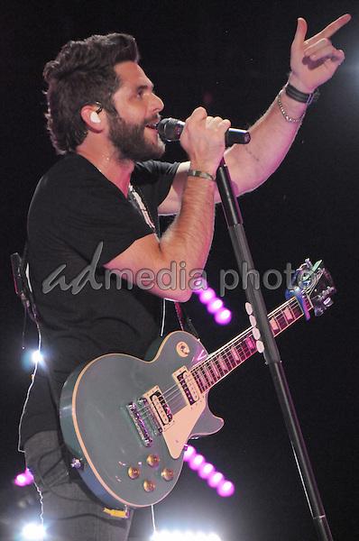 12 June 2016 - Nashville, Tennessee - Thomas Rhett. 2016 CMA Music Festival Nightly Concert held at Nissan Stadium. Photo Credit: Dara-Michelle Farr/AdMedia