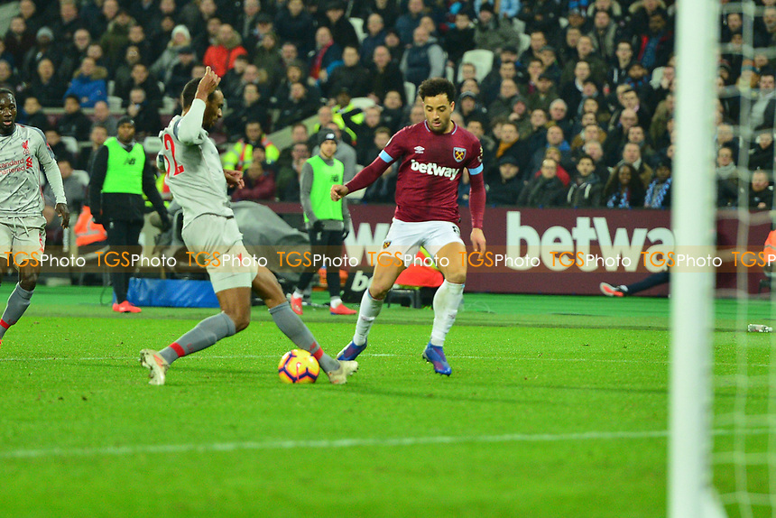 Joel Matip of Liverpool tackles Felipe Anderson during West Ham United vs Liverpool, Premier League Football at The London Stadium on 4th February 2019