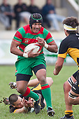Leaving Robert Wallis in his wake Sio Petelo looks to avoid Liam Dunn. Counties Manukau Premier Club Rugby game between Waiuku and Bombay, played at Waiuku on Saturday July 5th 2010. Waiuku won 59 - 14 after trailing 12 - 14 at halftme.