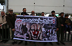 Palestinian supporters of el-Tahrir party holds poster of Russian President Vladimir Putin during a protest against his visit to the West Bank, in Gaza City January 23, 2020. Photo by Ashraf Amra