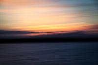 Sunset abstract created in-camera along the shores of the small boat lagoon at the San Leandro Marina Park on San Francisco Bay.