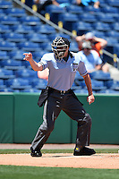 Home plate umpire Brennan Miller makes a call during a game between the Tampa Yankees and Clearwater Threshers on April 9, 2014 at Bright House Field in Clearwater, Florida.  Tampa defeated Clearwater 5-3.  (Mike Janes/Four Seam Images)