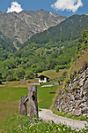 Road in Soglio, Switzerland a town the Bregaglia Valley that leads to barns and hiking trails; Graubunden Canton
