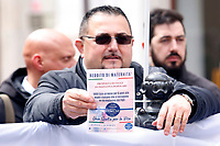 A man showing a law propose, that wants to give women 1000E per month for 8 years to Italian women that don't work to take care exclusively of their children <br /> Rome April 4th 2019. Demonstration of the People of Family. People of Family is a social conservative political movement in Italy.<br /> photo di Samantha Zucchi/Insidefoto