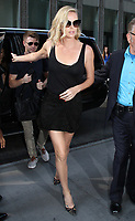 Charlize Theron Seen In NYC