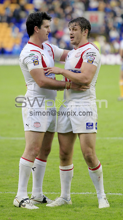Pix: Chris Mangnall /SWPix.com, Rugby League, Super League. 31/07/10  Warrington Wolves v St Helens Saints....picture copyright>>Simon Wilkinson>>07811267 706>>....St Helens's Chris Flannery and Jon wilkin congratulate each outher at end of game