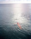 HONDURAS, Roatan, young woman floating in the Caribbean Sea