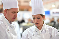 Melbourne, 30 May 2017 - Michael Cole and commis chef Laura Skvor of the Georgie Bass Cafe & Cookery in Flinders in discussions at the Australian selection trials of the Bocuse d'Or culinary competition held during the Food Service Australia show at the Royal Exhibition Building in Melbourne, Australia. Photo Sydney Low