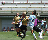 Chile, Chillan:Usa defen Lauren Fowlkes goes for the ball along with Florencia Jaimes during the football second match of the Fifa U-20 Women´s World Cup the at Nelson Oyarzún stadium in Chillán , on November 22 2008. Photo by Grosnia/ISIphotos.com