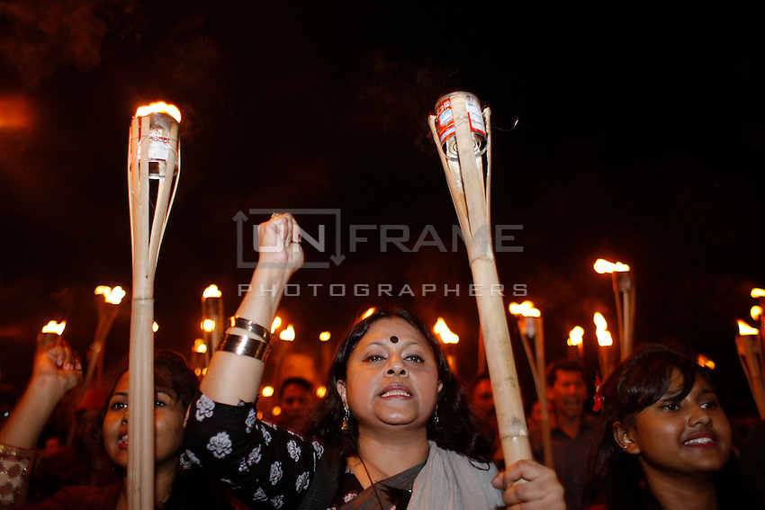 Bangladeshi social activists shout slogans as they participate in a torch rally held to protest against the killing of Avijit Roy, in Dhaka, Bangladesh. Friday, Feb. 27, 2015.