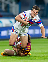Picture by Allan McKenzie/SWpix.com - 11/05/2018 - Rugby League - Ladbrokes Challenge Cup - Huddersfield Giants v Wakefield Trinity - John Smith's Stadium, Huddersfield, England - Wakefield's Joe Arundel is tackled by Huddersfield's Jake Mamo.