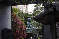 "A Buddha statue, Yanaka, Tokyo, Japan, April 20, 2012. Yanaka is part of Tokyo's ""shitamachi"" historic working class wards. Recently it has become popular with Japanese and foreign tourists for its many temples, shops, restaurants and relaxed atmosphere."