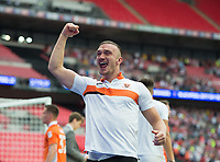 Blackpool's Tom Aldred celebrating after the Sky Bet League 2 PLAY OFF FINAL match between Exeter City and Blackpool at Wembley Stadium, London, England on 28 May 2017. Photo by Andrew Aleksiejczuk.