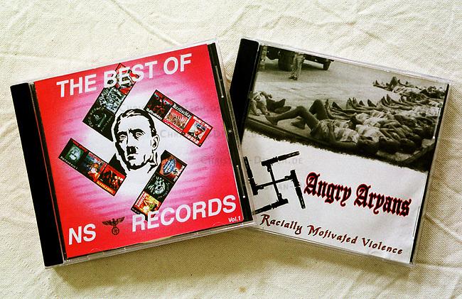 Neonazi Musik-CD's.<br /> Die oftmals in Osteuropa produzierten CD's werden in der Skinhead- und Neonazi-Szene zu horrenden Preisen Preisen verkauft und bescheren den Plattenfirmen phaenomenale Umsaetze. Die CD's enthalten z.T. indizierte und verbotene Musikstuecke.<br /> Hier: &quot;The Best von NS-Records&quot; und &quot;Angry Aryans - Racially Motivated Voilence&quot; (Wuetende Arier - Rassitisch motivierte Gewalt) aus Detroit.<br /> 19.9.2000<br /> Copyright: Christian-Ditsch.de<br /> [Inhaltsveraendernde Manipulation des Fotos nur nach ausdruecklicher Genehmigung des Fotografen. Vereinbarungen ueber Abtretung von Persoenlichkeitsrechten/Model Release der abgebildeten Person/Personen liegen nicht vor. NO MODEL RELEASE! Nur fuer Redaktionelle Zwecke. Don't publish without copyright Christian-Ditsch.de, Veroeffentlichung nur mit Fotografennennung, sowie gegen Honorar, MwSt. und Beleg. Konto: I N G - D i B a, IBAN DE58500105175400192269, BIC INGDDEFFXXX, Kontakt: post@christian-ditsch.de<br /> Bei der Bearbeitung der Dateiinformationen darf die Urheberkennzeichnung in den EXIF- und  IPTC-Daten nicht entfernt werden, diese sind in digitalen Medien nach &sect;95c UrhG rechtlich gesch&uuml;tzt. Der Urhebervermerk wird gemaess &sect;13 UrhG verlangt.]