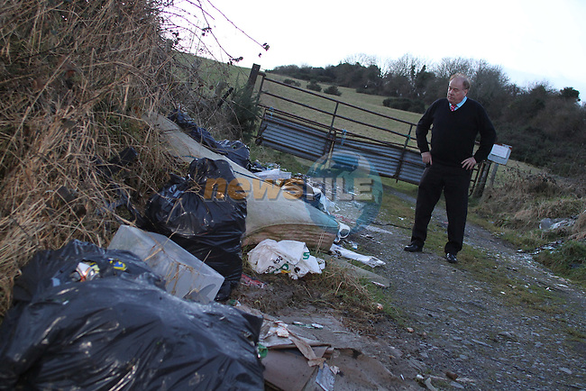 Frank Godfrey with Rubbish dumped in Donore, Co.Meath...(Photo credit should read Jenny Matthews/www.newsfile.ie)....This Picture has been sent you under the conditions enclosed by:.Newsfile Ltd..The Studio,.Millmount Abbey,.Drogheda,.Co Meath..Ireland..Tel: +353(0)41-9871240.Fax: +353(0)41-9871260.GSM: +353(0)86-2500958.email: pictures@newsfile.ie.www.newsfile.ie.