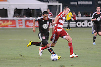 DC United midfielder Andy Najar (14) goes against FC Dallas midfielder Daniel Hernandez (2)  FC Dallas defeated DC United 3-1 at RFK Stadium, Saturday August 14, 2010.