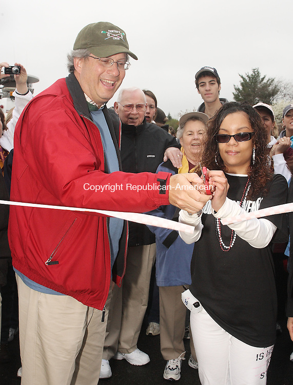 Cheshire, CT-050408MK01. Ciara's Dream Team leader, Ciara Rivera, who was diagnosed with multiple sclerosis when she was 15 and participated in last year's walk via the use of a wheelchair and walked the route this year, cuts the opening ribbon with DR. Bill Petit to signal the start of the 5 mile MS Walk at Cheshire High School Sunday morning.  LT. Kerry Deegan of the Cheshire Traffic Division estimated that there were nearly 3000 participants in annual charity fund raiser.  Michael Kabelka / Republican-American (Ciara Rivera, who was diagnosed with multiple sclerosis when she was 15 and participated in last year's walk via the use of a wheelchair and walked the route this year, cuts the opening ribbon with DR. Bill Petit)CQ