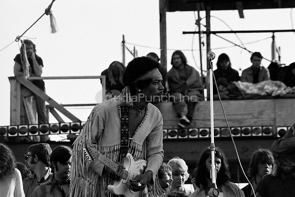 Jimi Hendrix performing his legendary 2 hour performance at Woodstock Music & Arts Festival held on Sam Yasgur's alfalfa field in Sullivan County, BethalNew York on August 18, 1969. Hendrix insisted he close the festival and was scheduled to appear at midnight but due to delays did not take the stage until 9 a.m. Monday morning. Most of the crowd had left for home by then and had dwindled from a whopping 500,000 to a measly 80,000. *** HIGHER RATES APPLY *** CALL TO NEGOTIATE RATE ** NEVER BEFORE PUBLISHED PHOTOS ** © Peter Tarnoff / MediaPunch