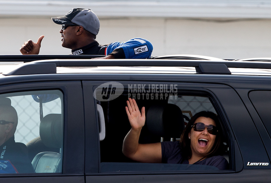 Sept. 1, 2013; Clermont, IN, USA: NHRA top fuel dragster driver Antron Brown and wife Billie Brown during qualifying for the US Nationals at Lucas Oil Raceway. Mandatory Credit: Mark J. Rebilas-
