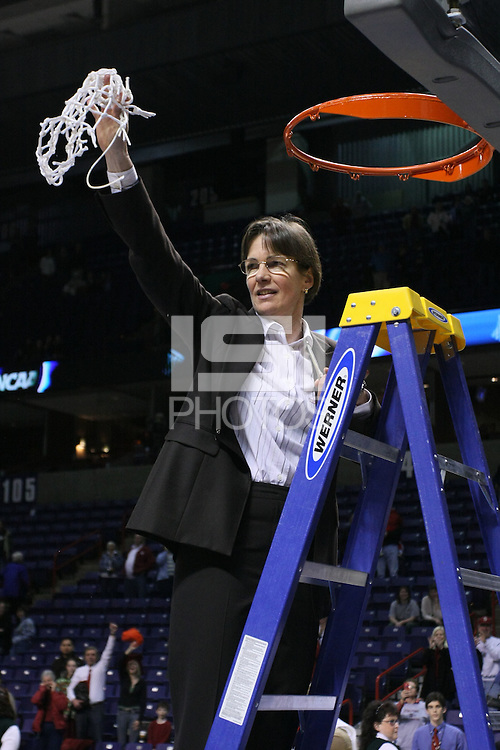 31 March 2008: Tara VanDerveer cuts down the net and celebrates after Stanford's 98-87 win over the University of Maryland in the elite eight game of the NCAA Division 1 Women's Basketball Championship in Spokane, WA.