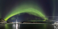 Panorama of the Northern lights and Alaska pipeline over the Tanana River in Alaska's interior