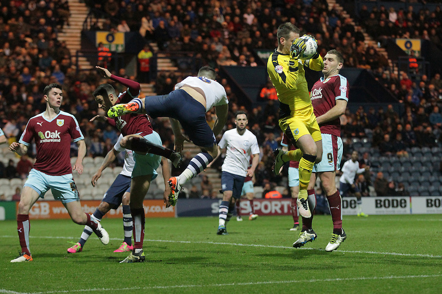 Burnley's goalkeeper Thomas Heaton collects the ball under pressure from Preston North End's Bailey Wright<br /> <br /> Photographer Stephen White/CameraSport<br /> <br /> Football - The Football League Sky Bet Championship - Preston North End v Burnley - Friday 22nd April 2016 - Deepdale - Preston <br /> <br /> &copy; CameraSport - 43 Linden Ave. Countesthorpe. Leicester. England. LE8 5PG - Tel: +44 (0) 116 277 4147 - admin@camerasport.com - www.camerasport.com