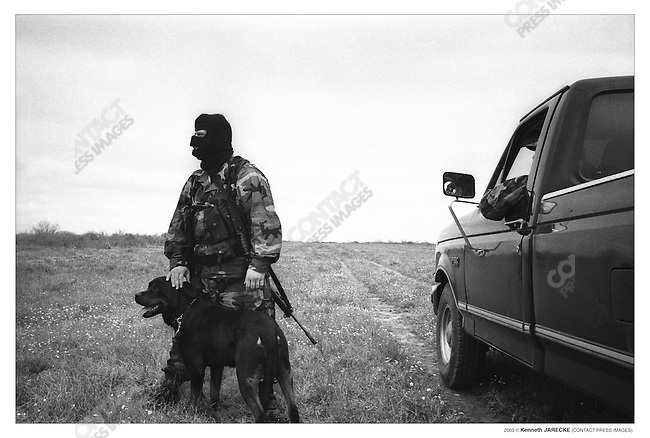 Civilian patrol group Ranch Rescue patrols a private ranch in Jim Hogg County, Texas, March 17, 2003.