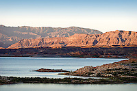 Lake Mead is the largest reservoir in the United States. It is located on the Colorado River about 30 miles southeast of Las Vegas, Nevada, in the states of Nevada and Arizona. Formed by water impounded by the Hoover Dam. Jagged mountain ranges surround the lake, offering somewhat of a startling but beautiful backdrop, especially at sunset. Lake Mead offers many types of recreation to locals and visitors. Boating is the most popular. Additional activities include fishing, water skiing, swimming and sunbathing.