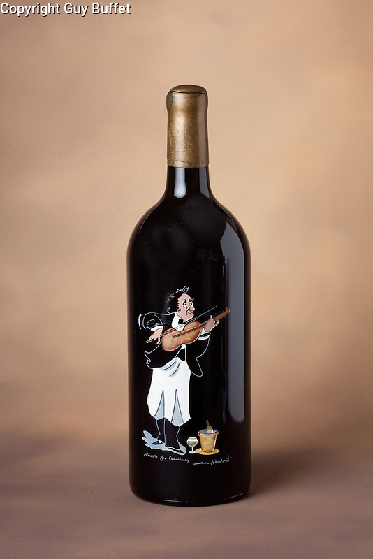 The Guy Buffet Collection c included exquisite etched wine bottles.<br />