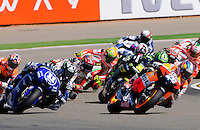 Dani Pedrosa leads Group Motogp Riders taking  a curve at Grand Prix Aragon 2012