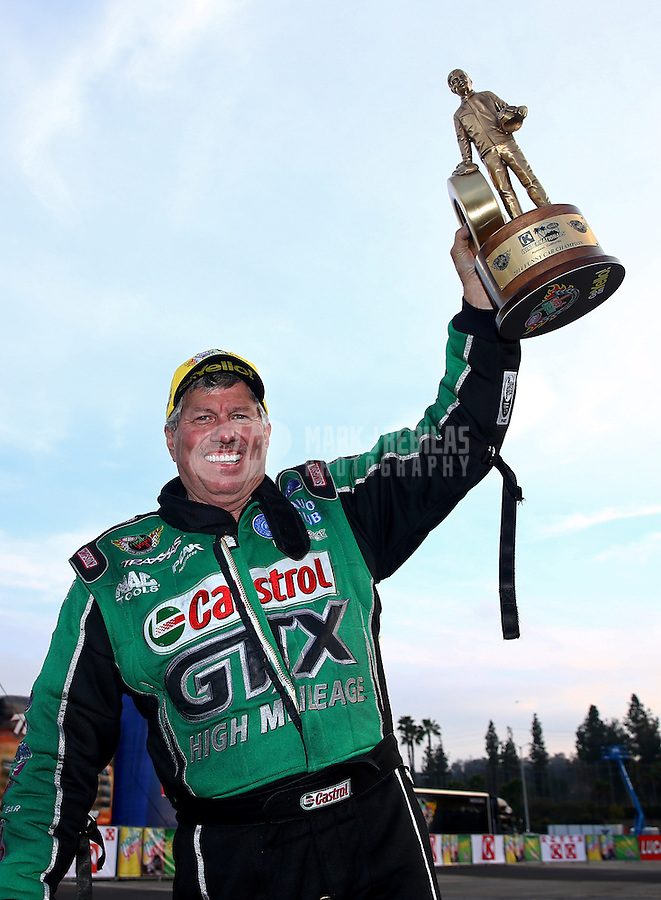 Feb 9, 2014; Pomona, CA, USA; NHRA funny car driver John Force celebrates after winning the Winternationals at Auto Club Raceway at Pomona. Mandatory Credit: Mark J. Rebilas-