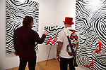"MIAMI, FL - DECEMBER 05: Artist Blake Emory with the Rock artist Floyd poses for a portrait during his debuts of provoking abstract collection of works ""Zebra Love"" at this year's Spectrum Miami exhibit during Art Basel Miami Beach on Friday December 5, 2014 in Miami, Florida. (Photo by Johnny Louis/jlnphotography.com)"
