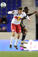 Seth Stammler (6) of the New York Red Bulls and Amobi Okogu (14) of the Philadelphia Union go up for a header. The New York Red Bulls defeated the Philadelphia Union 2-1 during a US Open Cup qualifier at Red Bull Arena in Harrison, NJ, on April 27, 2010.