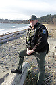 Dec 1, 2015:  Fish and Wild Life officer Bryan Davidson looks out on the waters of Fort Flagler State Park in Port Townsend, WA.