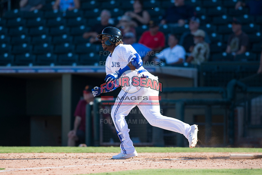 Surprise Saguaros third baseman Vladimir Guerrero Jr. (27), of the Toronto Blue Jays organization, hits a two-out two-RBI double in the bottom of the ninth inning of an Arizona Fall League game against the Salt River Rafters on October 9, 2018 at Surprise Stadium in Surprise, Arizona. The Rafters defeated the Saguaros 10-8. (Zachary Lucy/Four Seam Images)