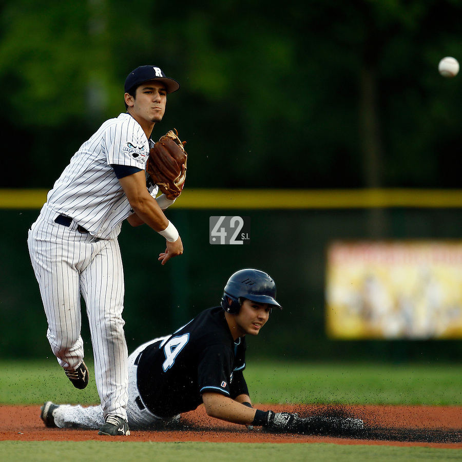 15 July 2011: Maxime Lefevre of the Rouen Huskies throws to first for the double play over Arthur Paturel during the 2011 Challenge de France match won 6-5 by the Rouen Huskies over the Senart Templiers at Stade Pierre Rolland, in Rouen, France.