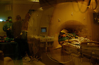 "San Francisco, California, January 6, 2011 - A view of patient Linda Sharpe during an iMRI surgery at University of California San Francisco Medical Center while. By using real time MRI scans of the brain, the surgeon can find the optimal trajectory for the electrodes ensuring the safest path while also precisely locating the precise point. Ms. Sharpe was diagnosed with Parkinson's disease about ten years ago and has steadily seen her condition decline. She says that she read everything she could on the subject and decided to try the iMRI at the suggestion of her neurologist, Dr. Chad Christine, a doctor at UCSF. Her PD has progressed to a point where the movement disturbances could no longer be alleviated with medication. She says she is hopeful about the surgery. ""I just want my quality of life back."" She added that she misses going out to dinner with her husband, taking walks along the beach where she lives and being able to read before going to bed. The procedure does not cure the disease, but should alleviate the symptoms for 7-10 years giving Ms. Sharpe the opportunity to regain some of these simple pleasures. ..The MRI machine photographs the patient during the surgery allowing the doctors operating to view the procedure as well as support doctors and technicians to monitor from an outside room.  The iMRI procedure uses Deep brain stimulation (DBS), which has been used for over a decade to treat movement disorders such as Parkinson's disease, essential tremor, and dystonia. DBS uses a pulse generator implanted in the chest, similar to a pacemaker, to deliver pulses to specific regions of the brain via a permanently implanted electrode. In the U.S., DBS is normally done while the patient is awake, because the surgeon needs to induce the symptoms (like the involuntary movements of Parkinson's) to know if he's in the right place, and if the patient is unconscious, the symptoms can't be induced. Many patients find it hard to tolerate. Their head is clamped in a f"