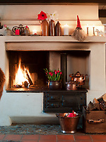 A roaring fire in the hearth banishes the winter cold from the living room