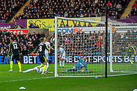 Lukasz Fabianski of Swansea City watches the ball go into the net during the English Premier League game between Arsenal and Swansea at the Liberty Stadium in Swansea ,Wales, UK. Saturday 14 January 2017