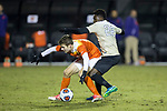 Grayson Raynor (14) of the Clemson Tigers keeps the ball away from Ema Twumasi (22) of the Wake Forest Demon Deacons during first half action at Spry Soccer Stadium on November 8, 2017 in Winston-Salem, North Carolina.  The Demon Deacons defeated the Tigers 2-1.  (Brian Westerholt/Sports On Film)
