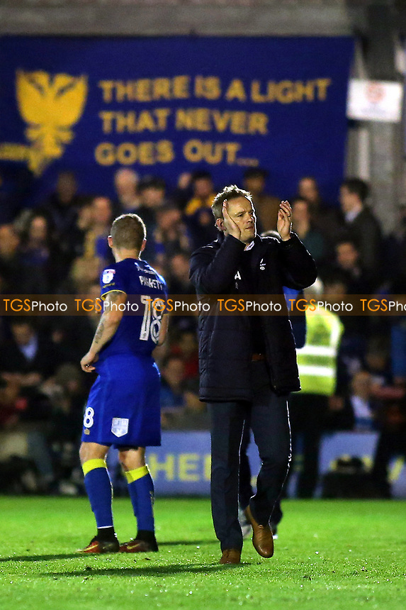 AFC Wimbledon Manager, Neal Ardley, applauds the home fans as he walks around the pitch to celebrate their historic victory during AFC Wimbledon vs MK Dons, Sky Bet EFL League 1 Football at the Cherry Red Records Stadium on 14th March 2017