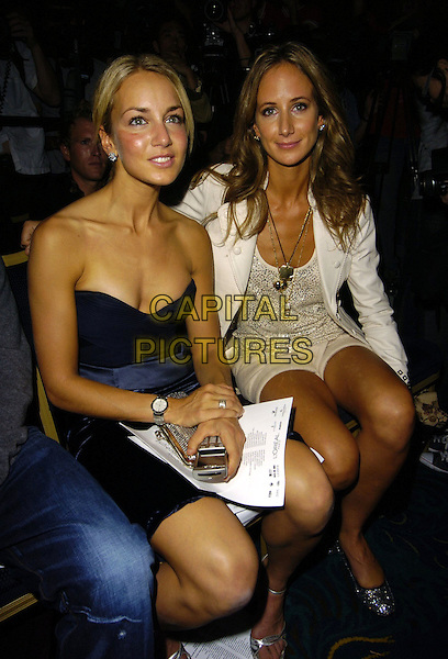 LADY ISABELA HERVEY & LADY VICTORIA HERVEY.At the Julien Macdonald Spring Summer 2007 Catwalk Show during London Fashion Week,.Hilton Park Lane Hotel, London,.England, September 22nd 2006..half length sitting blue strapless top dress sisters family siblings cream jacket top shirts tanned.Ref: CAN.www.capitalpictures.com.sales@capitalpictures.com.©Can Nguyen/Capital Pictures