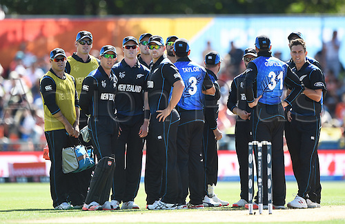 08.03.2015. Napier, New Zealand.  Players wait for a decision review during the ICC Cricket World Cup match between New Zealand and Afghanistan at McLean Park in Napier, New Zealand. Sunday 8 March 2015.