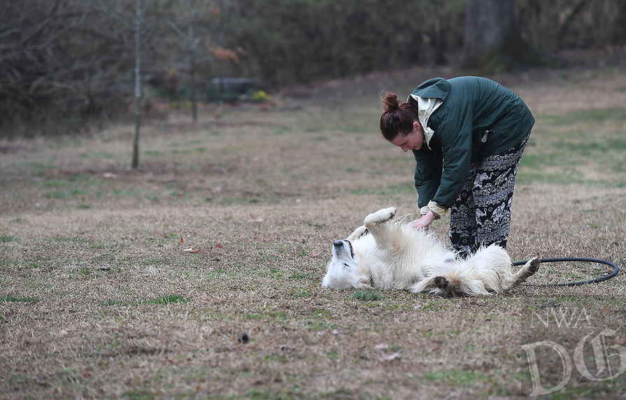 NWA Democrat-Gazette/J.T. WAMPLER Annie Sixbey of Fayetteville plays with her dog Nairobi Wednesday March 20, 2019 at Wilson Park in Fayetteville. Nairobi is a year and a half old golden retriever.