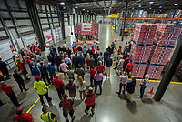 NWA Democrat-Gazette/J.T. WAMPLER Employees and guests attend the grand opening at a new Coca Cola distribution center in Lowell Monday Sept. 10, 2018. The new facility created 144 jobs and is owned by the Ozarks Coca-Cola/Dr. Pepper Bottling Company that distributes to parts of Missouri and Kansas as well as Northwest Arkansas.