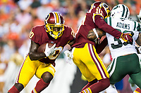 Landover, MD - August 16, 2018: Washington Redskins running back Rob Kelley (20) runs the football during preseason game between the New York Jets and Washington Redskins at FedEx Field in Landover, MD. (Photo by Phillip Peters/Media Images International)